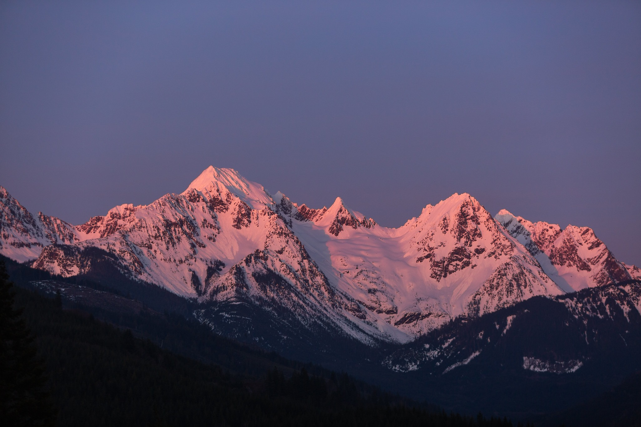 Alpine glow on mountain range at sunset